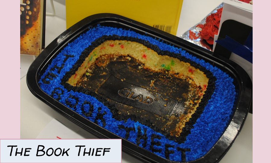 a cake with a book shaped piece missing, a pun on The Book Thief