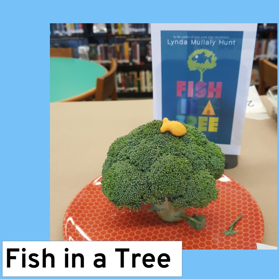 a picture of a goldfish cracker on top of a broccoli crown, a pun on the book title Fish in a Tree