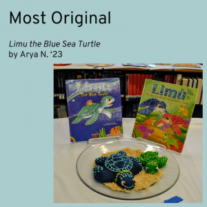 Winner of Most Original category, Limu the Blue Sea Turtle by Arya N. Two cakes in the shape of turtles, one blue and a smaller green one.