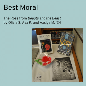 Winner for Best Moral category is The Rose from Beauty and the Beast. Picture shows a rose made out of pink candy glass and green frosting.