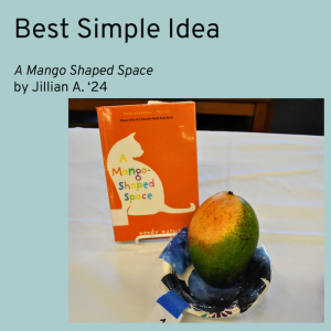 Best Simple Idea category winner is A Mango Shaped Space by Jillian A. Picture shows a mango fruit in a bowl. The bowl is decorated to look like outer space.
