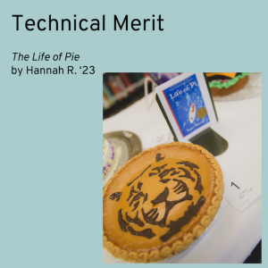 Winner of the Technical Merit category is The Life Of Pie by Hannah R. Picture is of a pumpkin pie with an intricate tiger face on it made of chocolate.